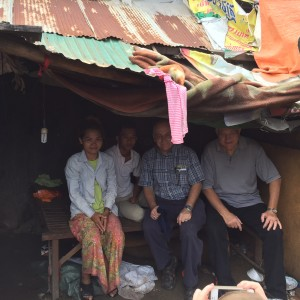 Missionary Johnny Esposito and I sharing the gospel in a Cambodian home